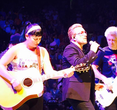 On stage with U2